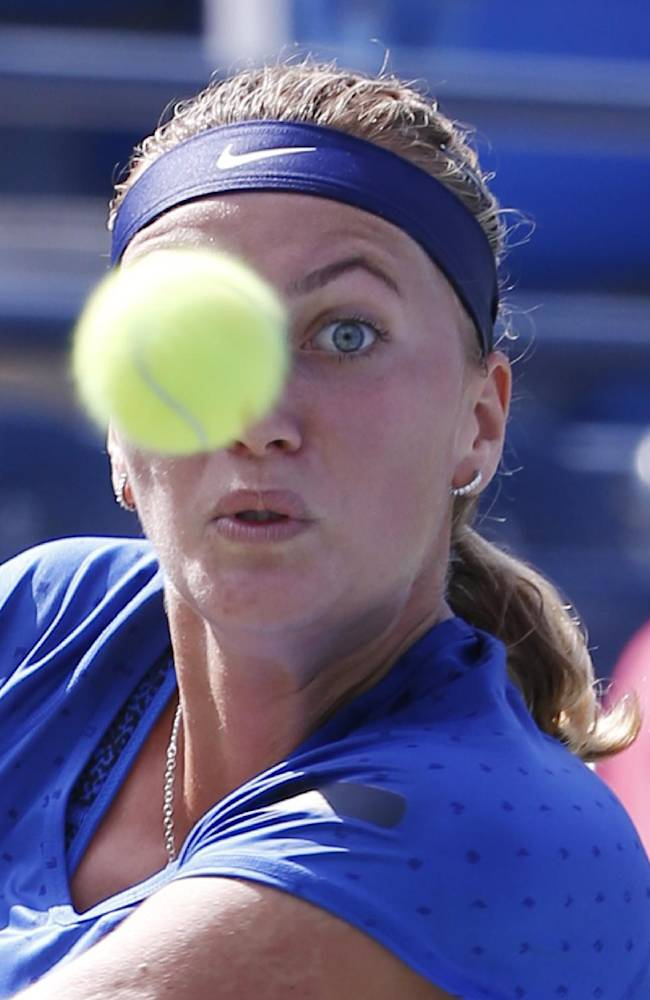 Petra Kvitova, of the Czech Republic, returns a shot to Aleksandra Krunic, of Serbia, during the third round of the 2014 U.S. Open tennis tournament, Saturday, Aug. 30, 2014, in New York