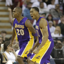 Los Angeles Lakers' Jodie Meeks, left, and Wesley Johnson celebrate after Meeks scored a three-point shot in the closing moments of an NBA basketball game against the Sacramento Kings in Sacramento, Calif., Friday, Dec. 6, 2013. The Lakers won 106-100 Th