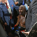 Dec 17, 2016; Los Angeles, CA, USA; Bernard Hopkins receives medical attention after he fell out of the ring in seventh round. Hopkins did not return to the ring in the required 20 seconds and Joe Smith Jr. was awarded the win on a TKO in their light heavyweight boxing fight at The Forum. Mandatory Credit: Jayne Kamin-Oncea-USA TODAY Sports
