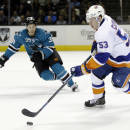 New York Islanders' Casey Cizikas (53) is chased by San Jose Sharks' Logan Couture (39) during the first period of an NHL hockey game on Tuesday, Dec. 10, 2013, in San Jose, Calif. (AP Photo/Marcio Jose Sanchez)