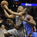 San Antonio Spurs guard Tony Parker, left, shoots against Oklahoma City Thunder forward Serge Ibaka during the first half of an NBA basketball game, Saturday, Dec. 21, 2013, in San Antonio. (AP Photo/Darren Abate)