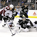Colorado Avalanche's Ryan O'Reilly, left, and Los Angeles Kings goalie Ben Scrivens go after the puck during the first period of an NHL hockey game on Saturday, Nov. 23, 2013, in Los Angeles The Associated Press
