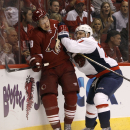 Phoenix Coyotes' Shane Doan (19) is checked into the boards by Karl Alzner (27) during the second period of an NHL hockey game, Saturday, Nov. 9, 2013 in Glendale, Ariz The Associated Press