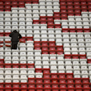 Seats a made ready at Anfield Stadium in Liverpool the day before Liverpool's Champion's League Group B soccer match against Real Madrid, Tuesday, Oct. 21, 2014