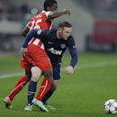 Olympiakos' Joel Campbell, left, fights for the ball with Manchester United's Wayne Rooney during their Champions League, round of 16, first leg soccer match at Georgios Karaiskakis stadium, in Piraeus port, near Athens, on Tuesday, Feb. 25, 2014