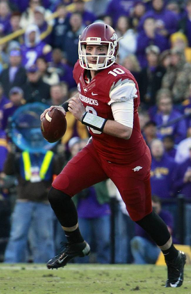 In this Nov. 29, 2013 file photo, Arkansas quarterback Brandon Allen (10) rolls out in the second half of an NCAA college football game against LSU in Baton Rouge, La. Bret Bielema has left little doubt this spring that Brandon Allen is Arkansas' best option at quarterback. Now the rising junior must prove he's fully recovered from an injury plagued last season and ready to help improve the SEC's worst passing attack