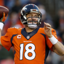 FILE - In this Dec. 7, 2014, file photo, Denver Broncos quarterback Peyton Manning passes against the Buffalo Bills during an NFL football game in Denver. A person with knowledge of the situation tells The Associated Press that Manning will return for a fourth season in Denver and 18th in the NFL. Manning will reduce his salary from $19 million to $15 million in 2015, according to the person who spoke on condition of anonymity because there was no official announcement. However, he can make up all of the $4 million pay cut by reaching certain performance benchmarks. (AP Photo/David Zalubowski, File)