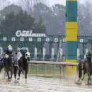 Far Right and jockey Mike Smith (6), right, leads the field down the stretch in the $300,000 Southwest Stakes horse race at Oaklawn Park in Hot Springs, Ark., Sunday, Feb. 22, 2015. (AP Photo/Danny Johnston)