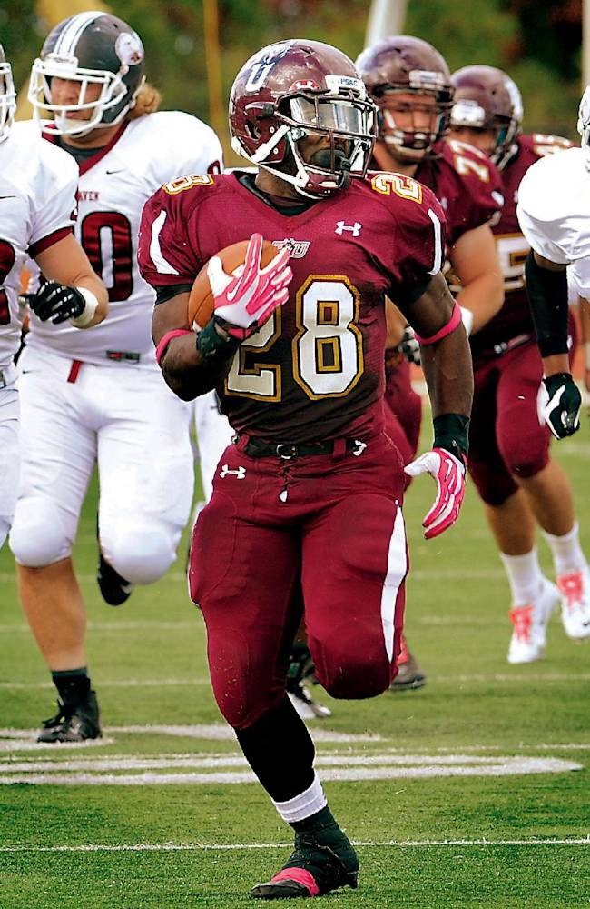 In this Sept. 28, 2013 photo, Bloomsburg University senior running back Franklyn Quiteh outruns Lock Haven University defenders on his way to a 61-yard touchdown in the second quarter of an NCAA college football game at Redman Stadium in Bloomsburg, Pa. West Texas A&M quarterback Dustin Vaughan and Quiteh have been selected to The Associated Press Little All-America team, Thursday, Dec. 19, 2013, which honors the top players in Division II, III and NAIA