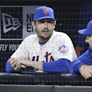 New York Mets starting pitcher Matt Harvey talks to a teammate before a baseball game against the St. Louis Cardinals Tuesday, April 22, 2014, in New York. The picture Harvey tweeted of himself making an obscene gesture on his way into surgery caused such