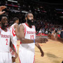 HOUSTON, TX - MARCH 1: James Harden #13 of the Houston Rockets high fives teammates after the Cleveland Cavaliers during the game on March 1, 2015 at the Toyota Center in Houston, Texas. (Photo by Bill Baptist/NBAE via Getty Images)
