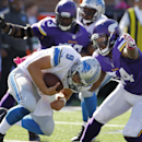 Detroit Lions quarterback Matthew Stafford (9) is sacked by Minnesota Vikings middle linebacker Jasper Brinkley (54) during the first half of an NFL football game Sunday, Oct. 12, 2014, in Minneapolis The Associated Press