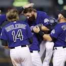 Rockies win, after losing end of suspended game The Associated Press