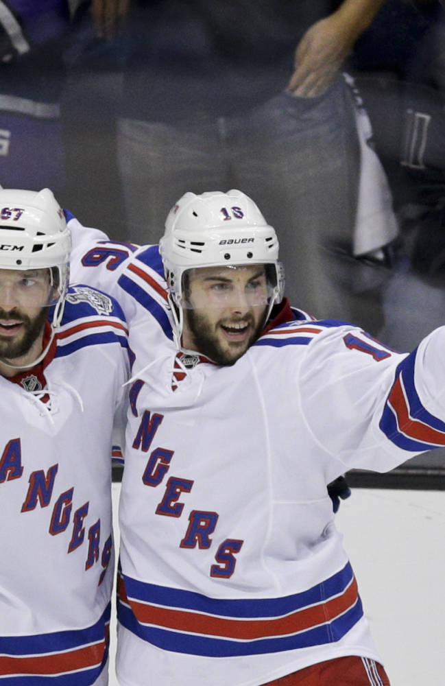 New York Rangers center Derick Brassard, right, celebrates his goal with left wing Benoit Pouliot against the Los Angeles Kings during the second period of Game 2 in the NHL hockey Stanley Cup Finals in Los Angeles, Saturday, June 7, 2014