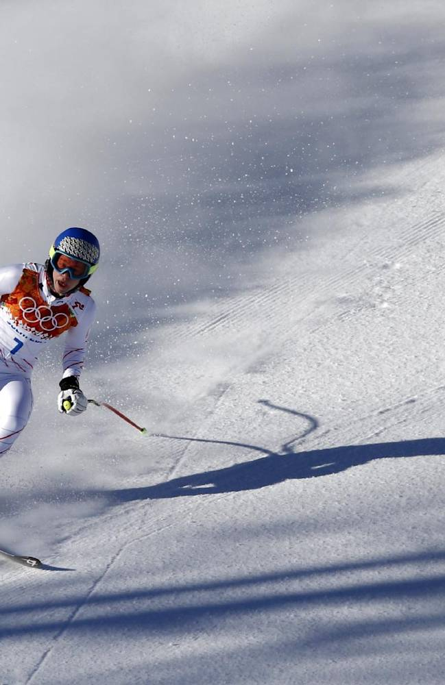 United States' Laurenne Ross comes to a halt  in the finish area after a women's downhill training run for the Sochi 2014 Winter Olympics, Thursday, Feb. 6, 2014, in Krasnaya Polyana, Russia