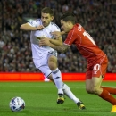 Liverpool's Philippe Coutinho, right, fights for the ball against Swansea's Angel Rangel during the English League Cup soccer match between Liverpool and Swansea at Anfield Stadium, Liverpool, England, Tuesday, Oct. 28, 2014