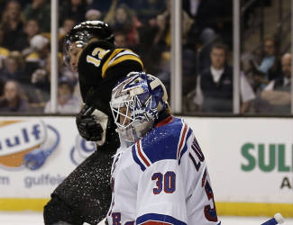 New York Rangers goalie Henrik Lundqvist (30) makes a save as Boston Bruins' Jarome Iginla looks for the rebound during the second period of an NHL hockey game in Boston, Friday, Nov. 29, 2013. (AP Photo/Winslow Townson)