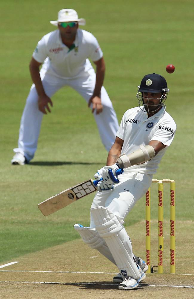 India's batsman Murali Vijay, right, avoids a bouncer as South Africa's fielder Jacques Kallis, left, watches during second day of their cricket test match at Kingsmead stadium, Durban, South Africa, Friday, Dec. 27, 2013