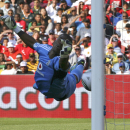 FILE- In this file photo dated Saturday July 23, 2011, Orlando Pirates goalkeeper Senzo Meyiwa dives but fails to stop the ball going below his hand, from a free kick by Tottenham Hotspur Rafael Van der Vaart, during the 2011 Vodacom Challenge at Ellis Pa