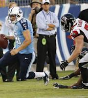 Tennessee Titans quarterback Jake Locker (10) runs out of the pocket against the Atlanta Falcons during the first half of an NFL preseason football game, Saturday, Aug. 24, 2013, in Nashville, Tenn. Locker fumbles on the play and Atlanta Falcons recovered. (AP Photo/John Russell)