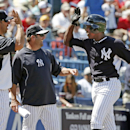 New York Yankees guest instructor Jorge Posada, left, and Yankees batting coach Kevin Long, center, greet New York Yankees Alfonso Soriano after Soriano hit a fourth-inning, two-run home run off Boston Red Sox relief pitcher Brandon Workman in a spring ex