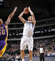 DALLAS, TX - JANUARY 7: Dirk Nowitzki #41 of the Dallas Mavericks shoots against the Los Angeles Lakers on January 7, 2014 at the American Airlines Center in Dallas, Texas. (Photo by Glenn James/NBAE via Getty Images)