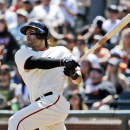 San Francisco Giants' Michael Morse hits a double against the Colorado Rockies during the fifth inning of a baseball game on Sunday, April 13, 2014, in San Francisco The Associated Press