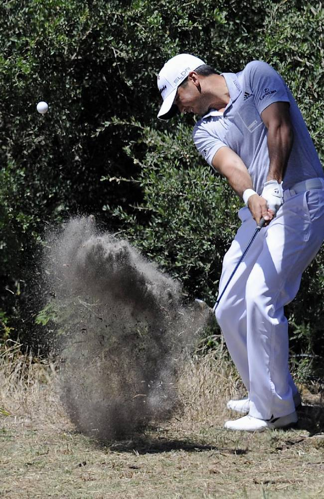 Jason Day of Australia hits out of the rough on the 11th hole during the second round of the World Cup of Golf at Royal Melbourne Golf Course in Melbourne, Australia, Friday, Nov. 22, 2013