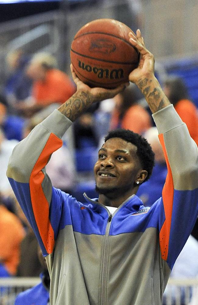 In this photo taken on Jan. 14, 2014, Florida's Chris Walker plays around on the sideline in Gainesville, Fla. The NCAA cleared the highly touted freshman on Wednesday, Jan. 29, 2014, and said he will be eligible to play Tuesday night against Missouri