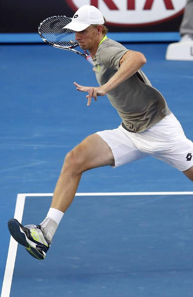 Kevin Anderson of South Africa chases a shot to Tomas Berdych of the Czech Republic during their fourth round match at the Australian Open tennis championship in Melbourne, Australia, Sunday, Jan. 19, 2014