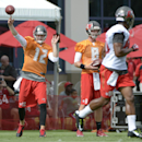 Tampa Bay Buccaneers quarterback Josh McCown (12) throws a pass as Mike Glennon (8) looks on during NFL football training camp in Tampa, Fla., Friday, July 25, 2014 The Associated Press