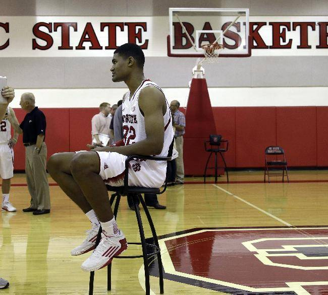 North Carolina State's Kyle Washington is interviewed during the team's NCAA college basketball media day in Raleigh, N.C., Monday, Sept. 30, 2013