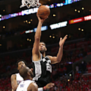 Spurs' Tim Duncan tells paper: 'I'll be back on the court' The Associated Press