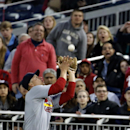 St. Louis Cardinals second baseman Mark Ellis catches a foul ball for an out on Washington Nationals' Jayson Werth during the third inning of a baseball game at Nationals Park, Friday, April 18, 2014, in Washington The Associated Press
