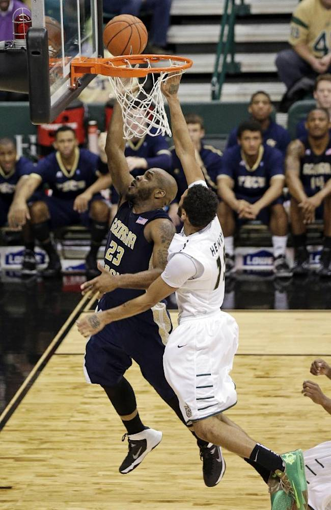 Georgia Tech's Trae Golden (23) drives past Charlotte's Pierria Henry during the second half of an NCAA college basketball game in Charlotte, N.C., Sunday, Dec. 29, 2013. Georgia Tech won 58-55