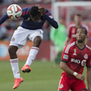 Chivas USA's Marvin Chavez, left, beats Toronto FC 's Justin Morrow to the ball during the second half of an MLS soccer game in Toronto on Sunday, Sept. 21, 2014 The Associated Press