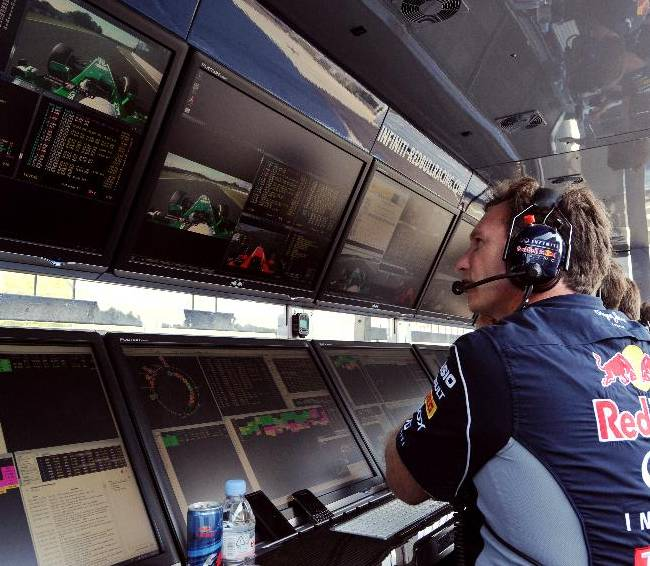 Red Bull team principal Christian Horner watches monitors during the qualifying session for the Japanese Formula One Grand Prix at the Suzuka circuit in Suzuka, Japan, Saturday, Oct. 12, 2013