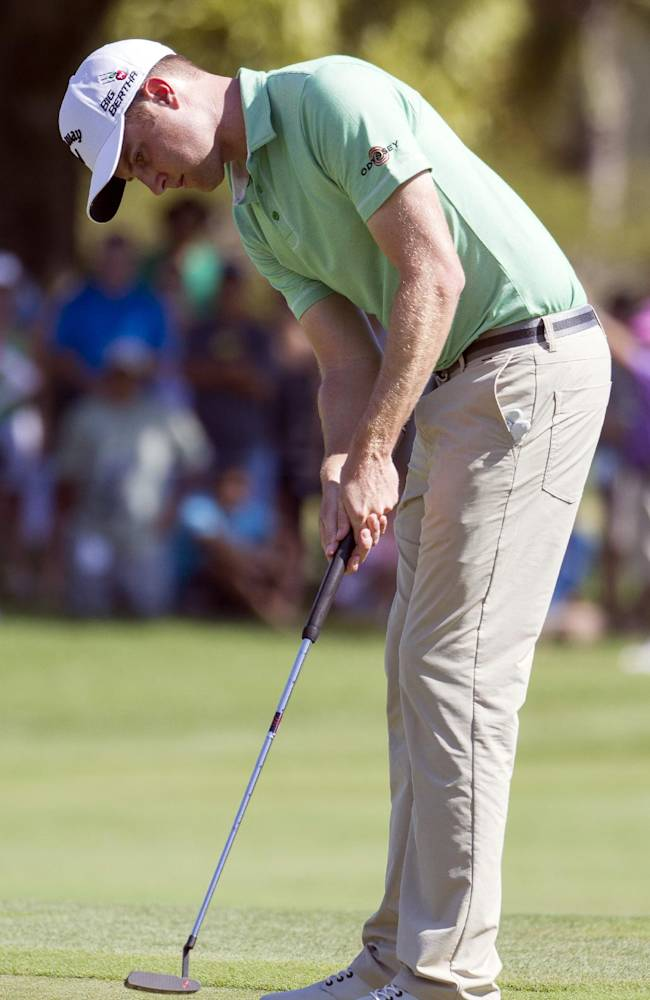 Chris Kirk watches his putt roll on the first Green during the fourth round of the Sony Open golf tournament at Waialae Country Club, Sunday, Jan. 12, 2014, in Honolulu