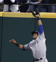 Texas Rangers' Nelson Cruz jumps for a ball hit by Cleveland Indians' Jason Kipnis in the sixth inning of a baseball game, Saturday, July 27, 2013, in Cleveland. Kipnis was out. (AP Photo/Tony Dejak)