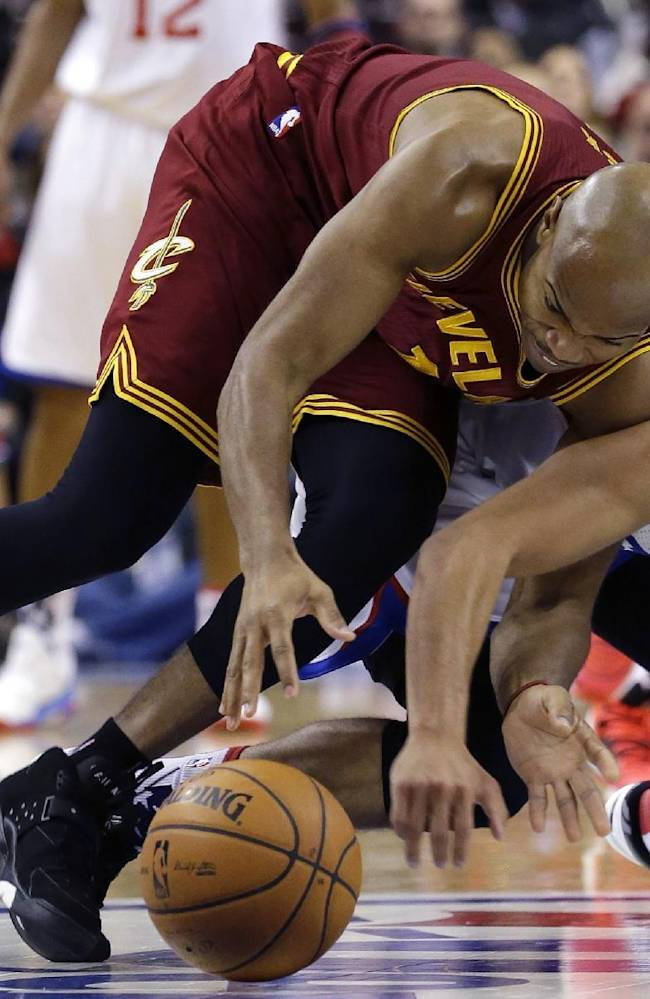 Cleveland Cavaliers' Jarrett Jack, left, and Philadelphia 76ers' Michael Carter-Williams dive for a loose ball during the second half of an NBA basketball game, Friday, Nov. 8, 2013, in Philadelphia. Philadelphia won 94-79