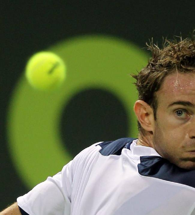 Filippo Volandri of Italy prepares to return the ball to Fernando Verdasco of Spain during the Qatar ATP Open Tennis tournament in Doha, Qatar, Monday Dec. 30, 2013
