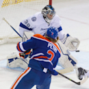 Tampa Bay Lightning goalie Ben Bishop (30) makes a save on Edmonton Oilers defenceman Jeff Petry (2) during second period NHL hockey action in Edmonton, Alberta, on Monday October 20, 2014 The Associated Press
