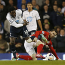 Tottenham Hotspur's Emmanuel Adebayor, left, tussles with Cardiff City's Jordon Mutch during their English Premier League soccer match at White Hart Lane, London, Sunday, March 2, 2014