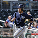 Milwaukee Brewers' Jonathan Lucroy races home to score on a single by Lyle Overbay in the fourth inning of a spring exhibition baseball game against the Cleveland Indians Wednesday, March 26, 2014, in Goodyear, Ariz The Associated Press