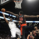 Brooklyn Nets' Marcus Thornton (10) is fouled by Toronto Raptors' Amir Johnson (15) in the first half of an NBA basketball game on Monday, March 10, 2014 at Barclays Center in New York The Associated Press