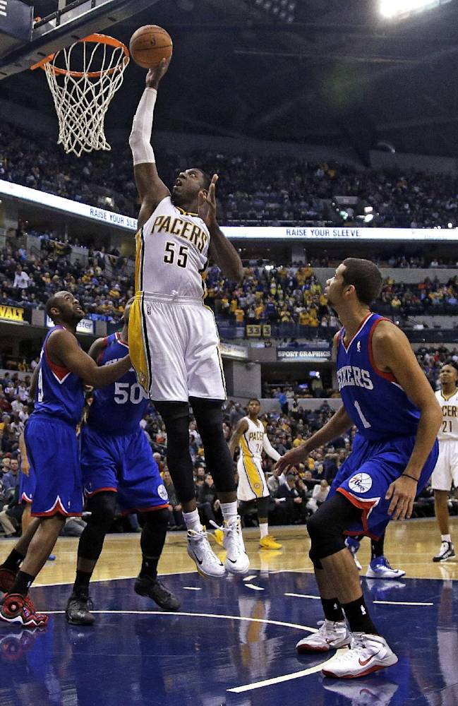Indiana Pacers center Roy Hibbert (55) shoots between Philadelphia 76ers defenders Michael Carter-Williams (1), Lavoy Allen (50) and James Anderson (9) during the second half of an NBA basketball game in Indianapolis, Saturday, Nov. 23, 2013. The Pacers won 106-98