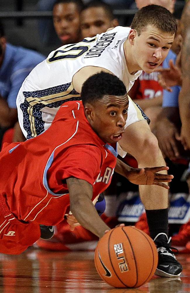 Delaware State's Kendal Williams, left, dives for a loose ball against Georgia Tech's Travis Jorgenson during the first half of an NCAA college basketball game, Monday, Nov. 11, 2013, in Atlanta