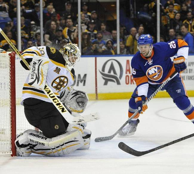 New York Islanders' Thomas Vanek (26) watches Boston Bruins goalie Chad Johnson (30) block a shot on goal in the second period of an NHL hockey game at the Nassau Coliseum on Saturday, Nov. 2, 2013, in Uniondale, N.Y. Vanek later scored in the second period. The Islanders won 3-1