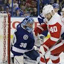Detroit Red Wings left wing Henrik Zetterberg (40), of Sweden, is stopped by Tampa Bay Lightning goalie Ben Bishop (30), defenseman Braydon Coburn (55) and right wing Nikita Kucherov (86), of Russia, during the third period of Game 2 of a first-round NHL Stanley Cup hockey playoff series Saturday, April 18, 2015, in Tampa, Fla. The Lightning won the game 5-1. (AP Photo/Chris O'Meara)