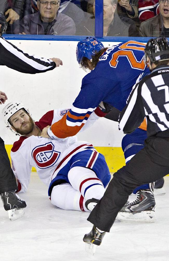 Montreal Canadians' Brandon Prust (8) is knocked down during a fight with Edmonton Oilers' Luke Gazdic (20) during first-period NHL hockey game action in Edmonton, Alberta, Thursday, Oct. 10, 2013. (AP {Photo/The Canadian Press, Jason Franson)